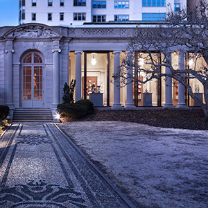 Wall-mounted cases with Optium vitrines in The Frick Collection's recently enclosed portico